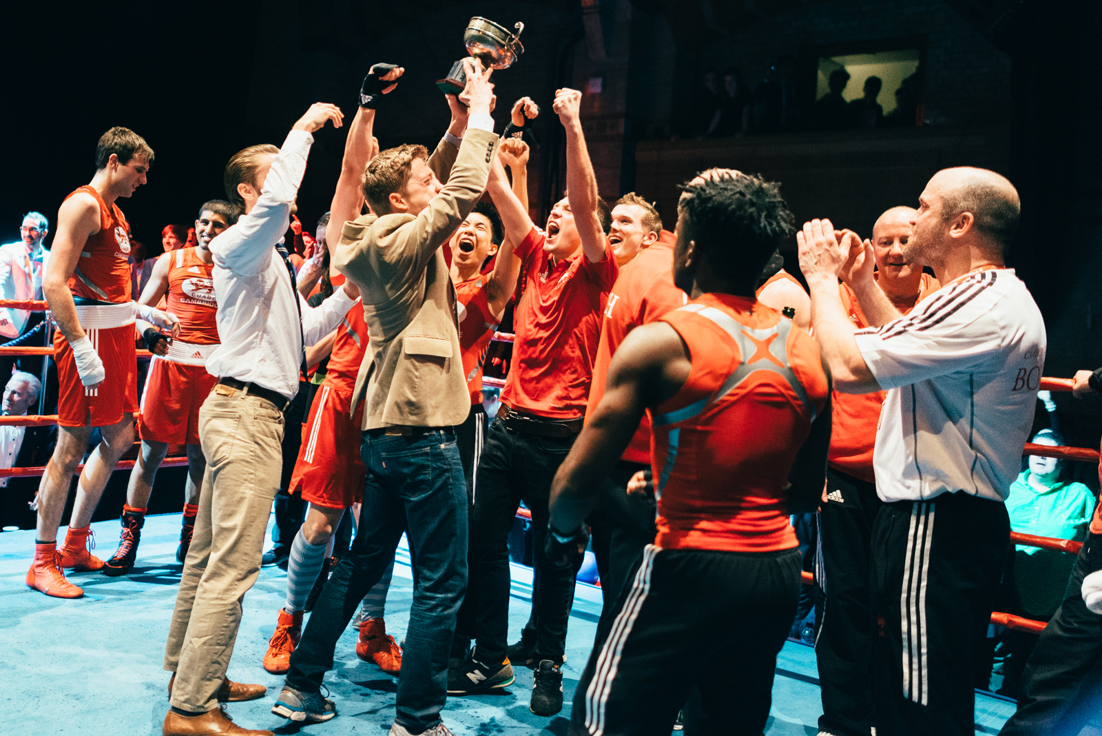 CUABC Team Celebrates In The Ring With Their Coaches [Photo Credit: John Fahy]