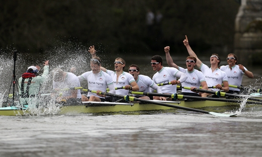 LONDON, ENGLAND - APRIL 03:  The Cambridge crew celebrate victory during the 156th Oxford and Cambridge University Boat Race on the River Thames on April 3, 2010 in London, England.  (Photo by Ian Walton/Getty Images)