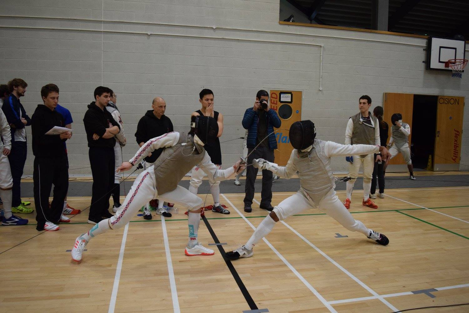 The Blues Fencing Team battling with the opposition.